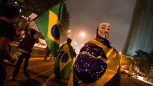Protesters draped in Brazilian flags take to streets in Sao Paulo