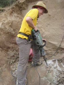Me using a jackhammer to clear away sandstone